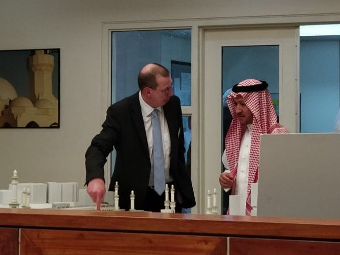 His Excellency the Department Head with a Member of the German Organization's Delegation
