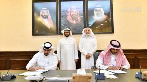 College of Community Signs a Cooperation Agreement with Wafaa Office for the Care of the Children of the Martyrs