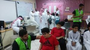 كلية الصحة العامة تشارك مدينة الملك عبدالله الطبية الاحتفال باليوم العالمي للتطوع